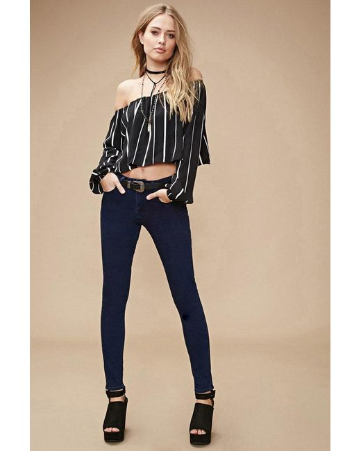 Forever 21   Blue Mid-rise Skinny Jeans   Lyst