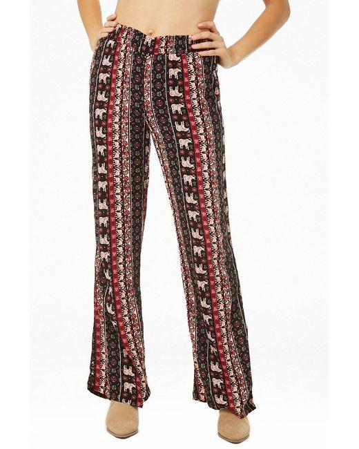 0603af60585 ... Forever 21 - Red Smocked Ornate Flare Pants - Lyst