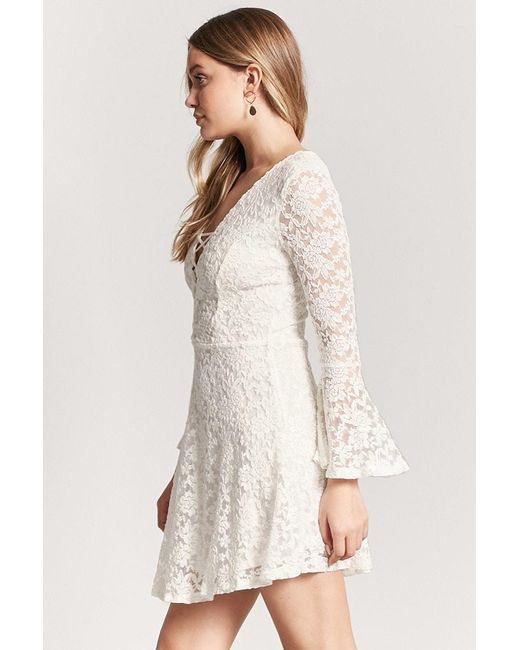 6f1d015b9b3 ... Forever 21 - White Lace Bell-sleeve Dress - Lyst