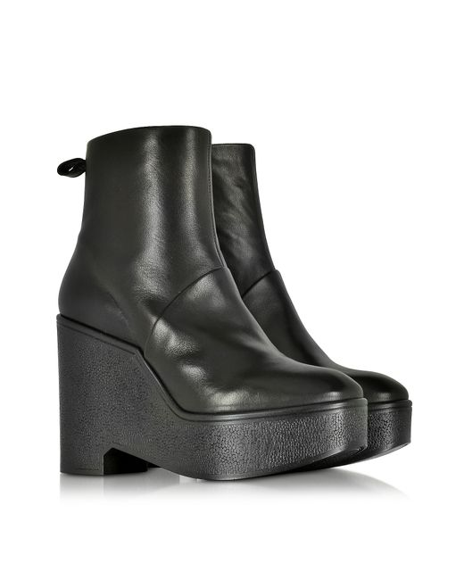 robert clergerie bisout black leather wedge boot in black
