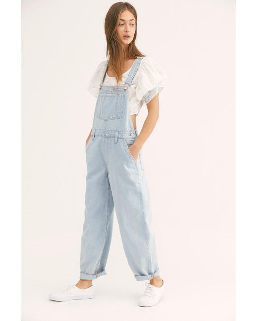 3adc19c7 ... Free People - Blue Levi's Baggy Denim Overalls - Lyst