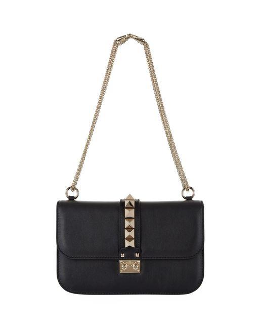 lyst valentino medium rockstud lock bag in black. Black Bedroom Furniture Sets. Home Design Ideas