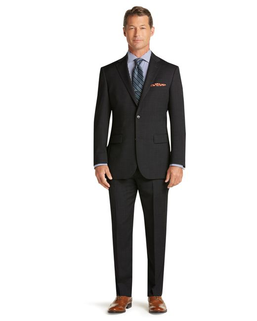Lyst jos a bank traveller collection tailored fit suit for Jos a bank tailored fit vs slim fit shirts
