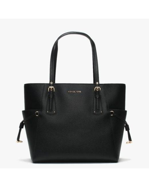 70c3f279a40c Michael Kors - Voyager East West Black Saffiano Leather Tote Bag - Lyst ...