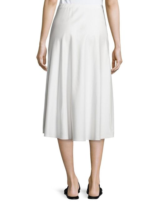 the row zedela a line midi skirt in white save 20 lyst