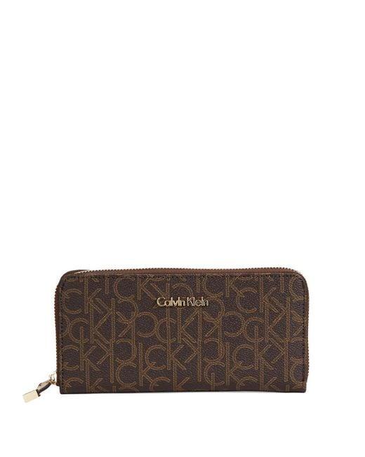 Calvin Klein | Brown Monogrammed Zip Around Wallet | Lyst