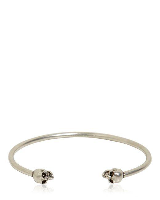 Alexander McQueen - Metallic Twin Skulls Bracelet - Lyst