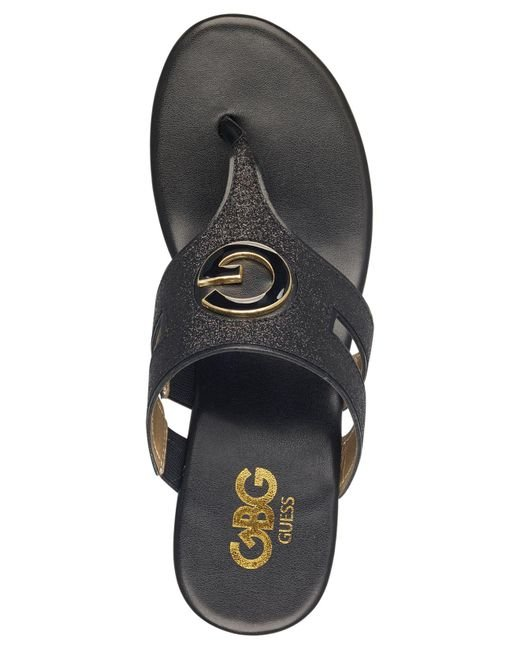 22692f96a ... G by Guess - Black Gandy Wedge Sandals - Lyst ...