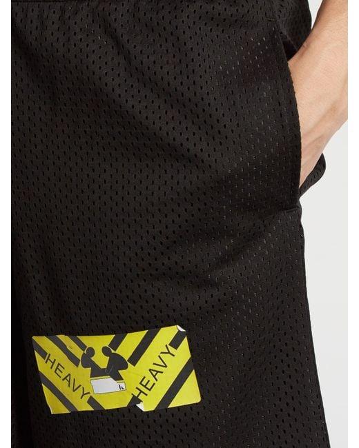off white c o virgil abloh spray paint mesh shorts in black for men. Black Bedroom Furniture Sets. Home Design Ideas