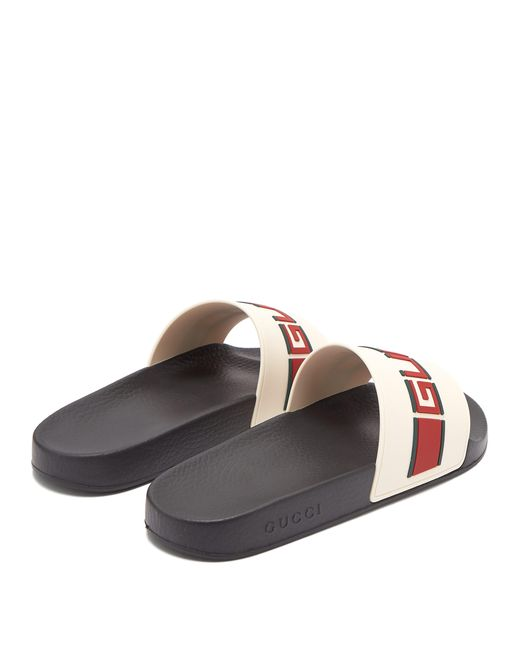 9a6696ac8cc6a9 ... Gucci - Multicolor Logo Embossed Rubber Slides for Men - Lyst ...