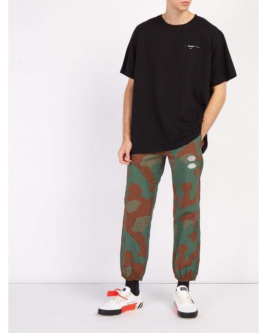 7f513b7fb680 ... Off-White c o Virgil Abloh - Green Pantalon de jogging à imprimé  camouflage ...