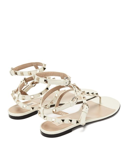 34ac32a9814 ... Valentino - White Rockstud Gladiator Leather Sandals - Lyst ...