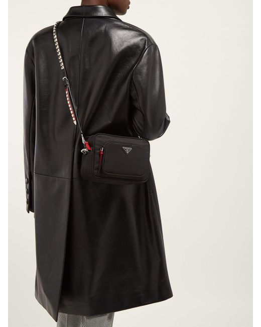539641115ae1d7 ... Prada - Black New Vela Mini Studded Nylon Cross Body Bag - Lyst ...