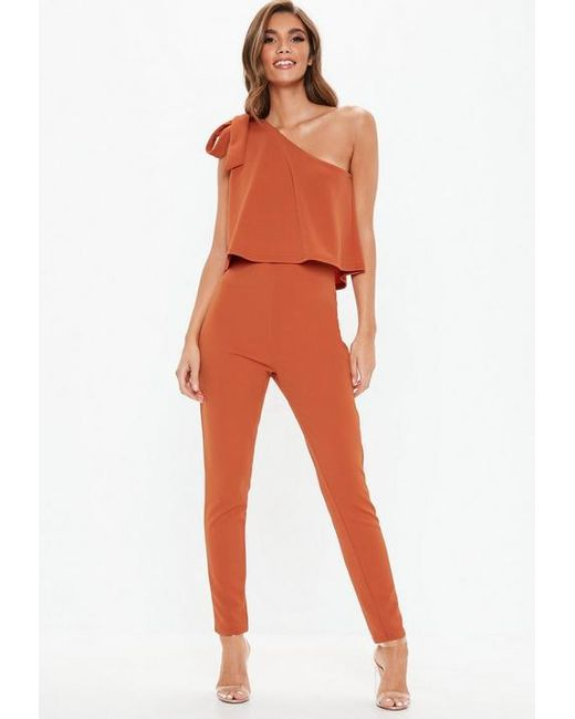 d81ee6be2ba Missguided Rust One Shoulder Bow Jumpsuit in Orange - Lyst