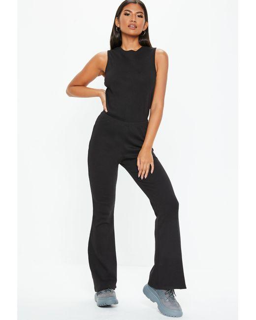 3eac64bdf90b Missguided Black Rib Flare Leg Sleeveless Jumpsuit in Black - Lyst