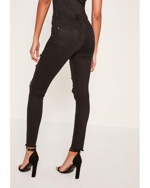 ... Missguided - Black Sinner High Waisted Extreme Ripped Skinny Jeans -  Lyst 14a1fbe59908