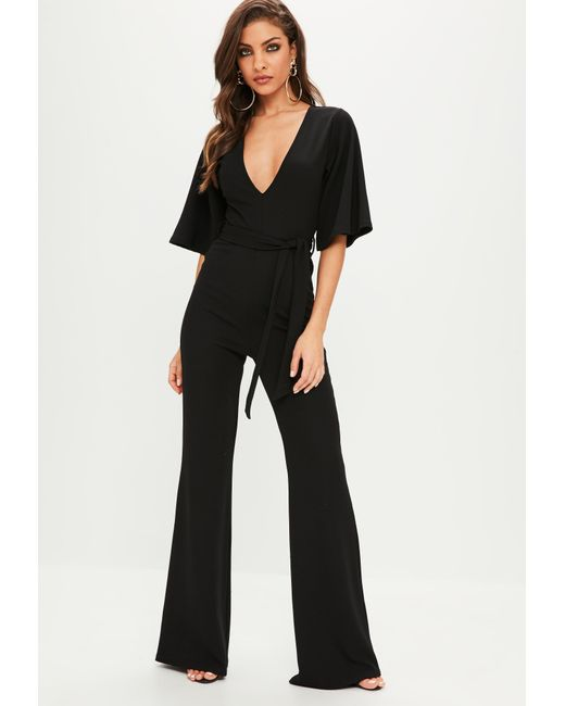 fad8ef9217 ... Missguided - Black Plunge Kimono Sleeve Jumpsuit - Lyst ...