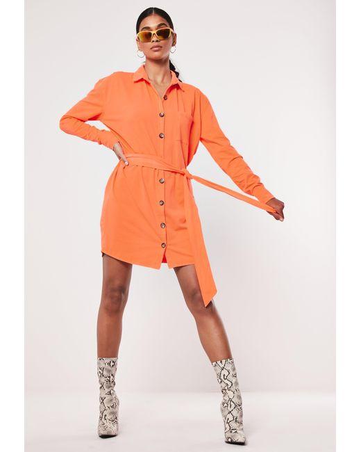 5566c8de73 ... Missguided - Neon Orange Jersey Tie Waist Utility Shirt Dress - Lyst ...