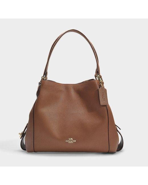8b9f889f66 COACH - Polished Pebble Leather Edie 31 Shoulder Bag In Brown Calfskin -  Lyst ...