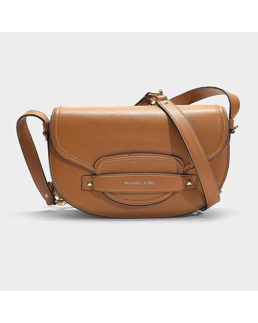 823412b13e09 MICHAEL Michael Kors - Cary Medium Saddle Bag In Brown Calfskin - Lyst ...