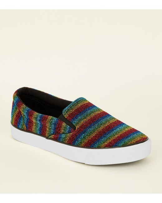 c8f3abc9ccb New Look Rainbow Sparkle Slip On Trainers in Blue - Lyst