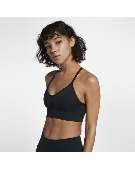 e88e02e781bf5 Lyst - Nike Seamless Women s Light Support Sports Bra in Black
