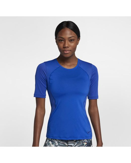 ccdac87444af Lyst - Nike Pro Hypercool Women s Short Sleeve Training Top in Blue