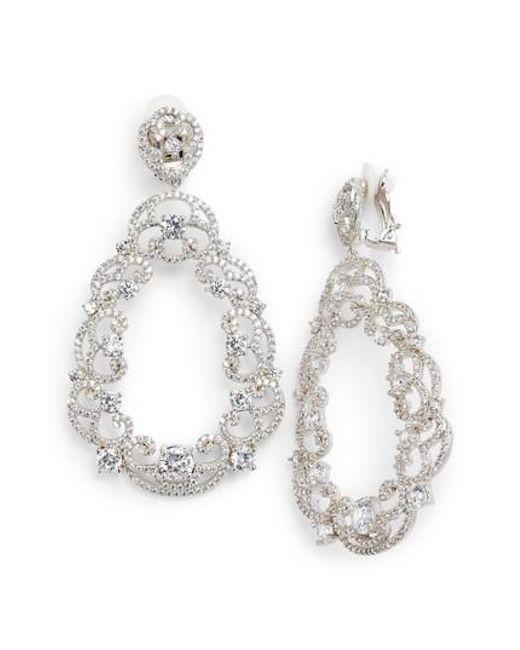 Nina - Metallic Scroll Pave Earrings - Lyst