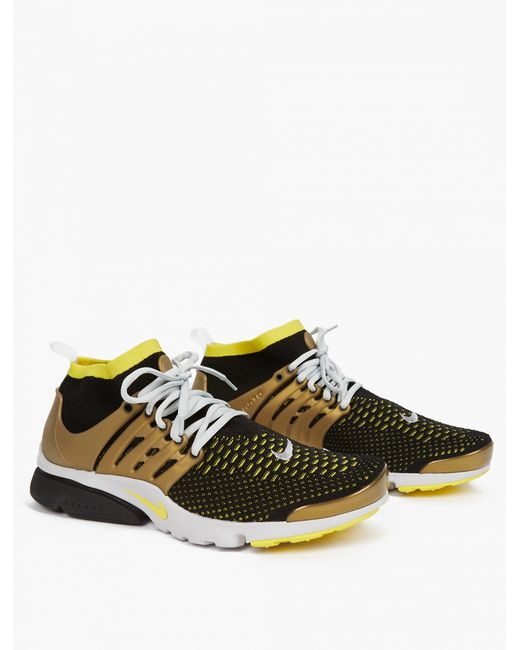 nike gold air presto flyknit ultra sneakers in black for. Black Bedroom Furniture Sets. Home Design Ideas
