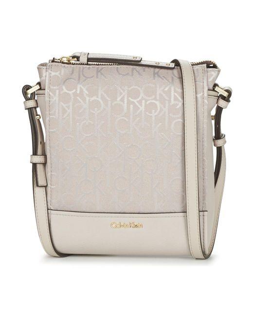 Calvin Klein Jeans | Natural Marina Logo Flat Crossbody Shoulder Bag | Lyst