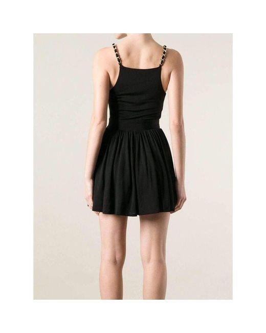 58a1f7ba ... Balmain - Black Fitted Wrap Metal Chain Straps Dress - Lyst ...