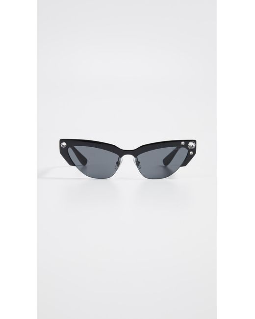 b9c3e50e9363 Miu Miu - Multicolor Narrow Cat Eye Sunglasses - Lyst ...