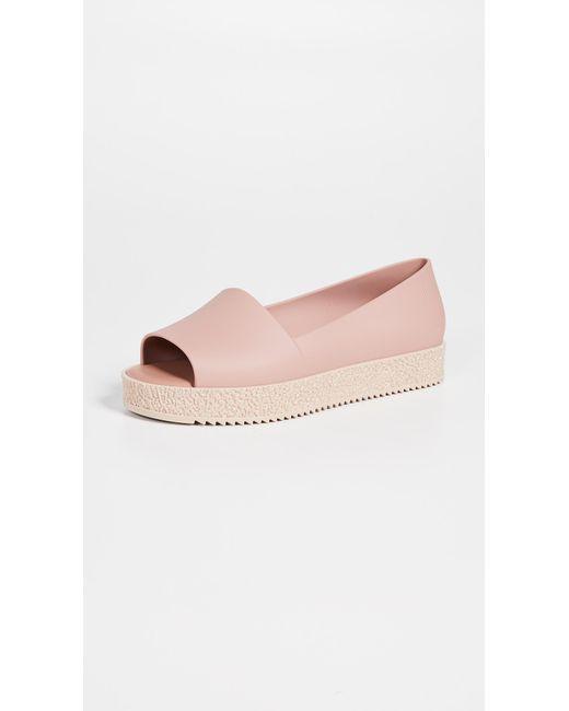 38928114ebb Melissa - Pink Puzzle Ad Flats - Lyst ...