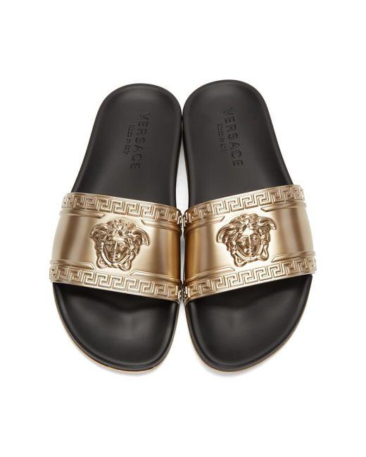 a5239ea07c21 ... Versace - Metallic Gold-tone Medusa Embossed Slides for Men - Lyst ...
