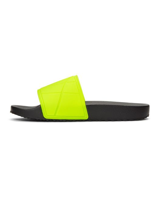 7cbc7362443a Prada Logo-embossed Rubber Slides in Yellow for Men - Save 29% - Lyst