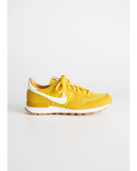 nike internationalist yellow