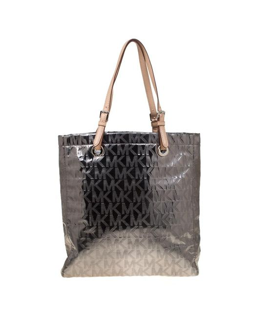 fca8c30dab81 ... MICHAEL Michael Kors - Metallic Silver Signature Patent Leather Jet Set  North South Tote - Lyst ...