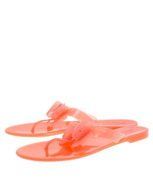 9ded68efde5cc ... Ferragamo - Pink Blush Jelly Pandy Bow Detail Flat Thong Sandals - Lyst  ...