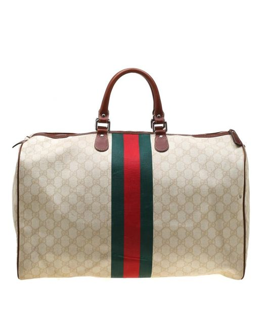 2e71c3188 ... Gucci - Natural Light Beige GG Supreme Coated Canvas Web Duffle Bag for  Men - Lyst ...