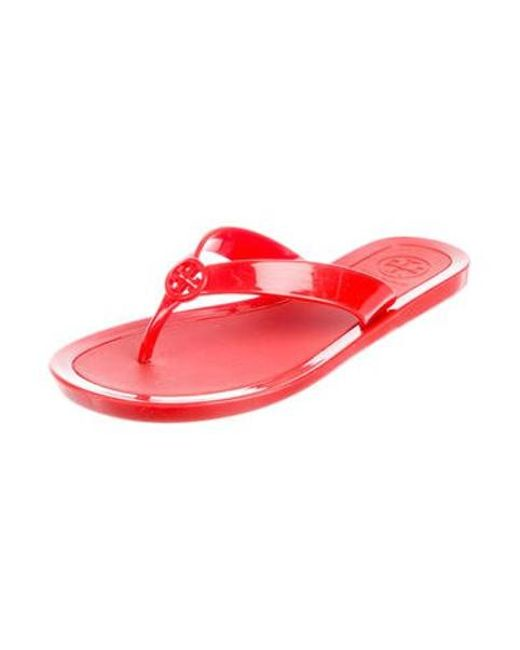 dc5b23c5f00342 ... Tory Burch - Red Jelly Thong Sandals - Lyst ...