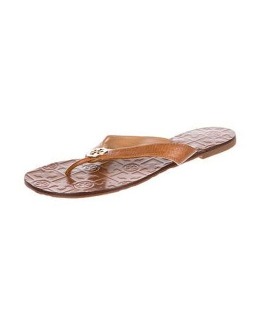 8b9f918d0b35 ... Tory Burch - Metallic Leather Thong Sandals Gold - Lyst ...