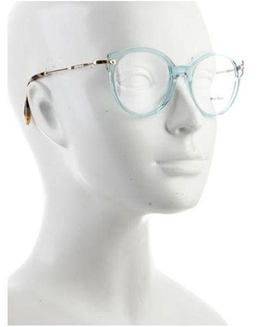 b7049e9ffc5 ... Miu Miu - Blue Miu Logo Round Eyeglasses - Lyst