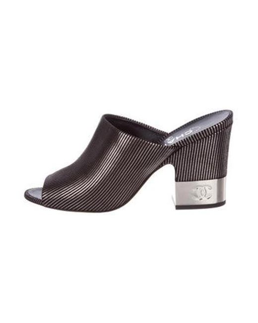9c9e46d6f2f3 Chanel - Metallic 2018 Cc Slide Sandals Black - Lyst ...