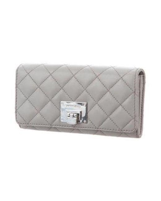 ee60b75ce42a2 ... MICHAEL Michael Kors - Metallic Michael Kors Astrid Leather Wallet Grey  - Lyst ...