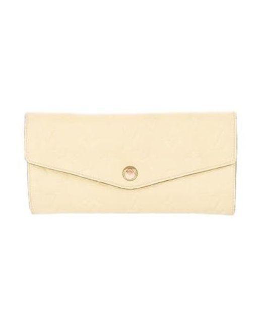 12d1909a8c72 Louis Vuitton - Metallic Empreinte Curieuse Wallet Brass - Lyst ...
