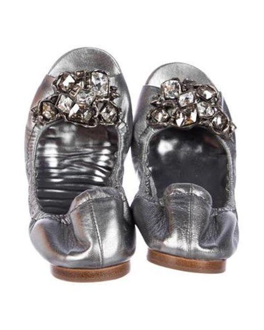 5acf2e89b7fc ... Miu Miu - Metallic Miu Leather Embellished Flats Silver - Lyst