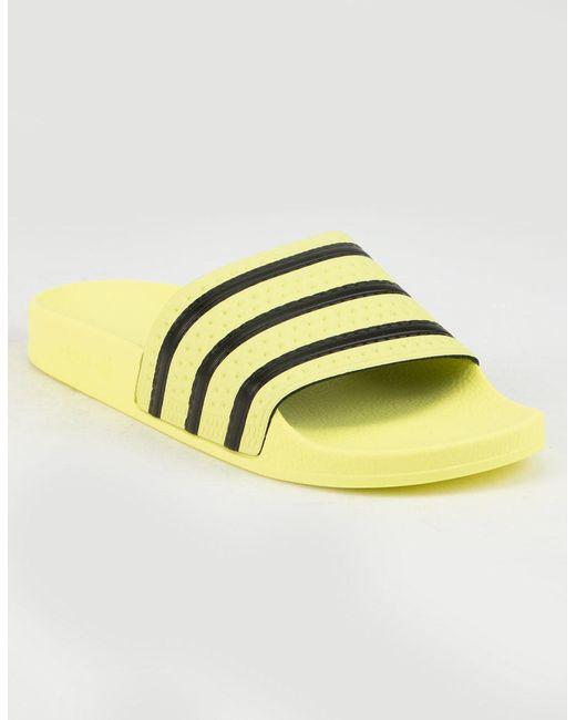 ecd57f954d52a5 Lyst - adidas Adilette Yellow Womens Sandals in Yellow