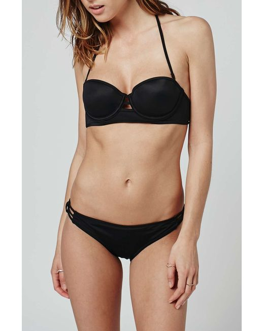 Click Here For Size Chart. Look Va-Va-Voom in this Sara Cutout Underwire Cups Bikini Top featuring a black undewire bikini top with triangle cutout cups, metal o .