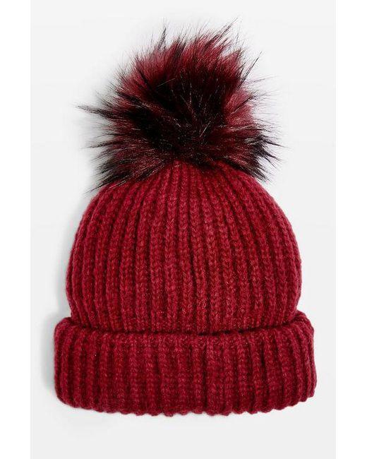 38d34d97a6e ... TOPSHOP - Red Tip Faux Fur Pom Pom Beanie - Lyst