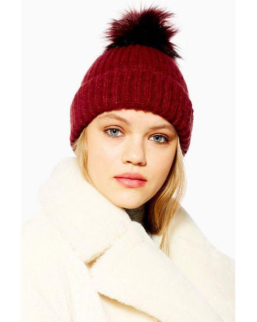 2ee7132e628 TOPSHOP - Red Tip Faux Fur Pom Pom Beanie - Lyst ...